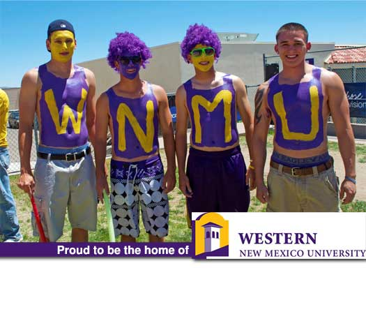 Four Students in Purple and Yellow Paint Spelling WNMU